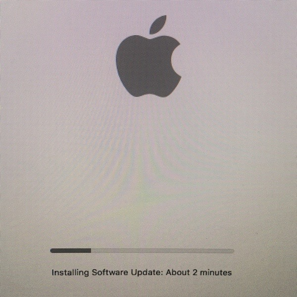 Installing macOS update with progress bar shown. Text says: about 2 minutes left