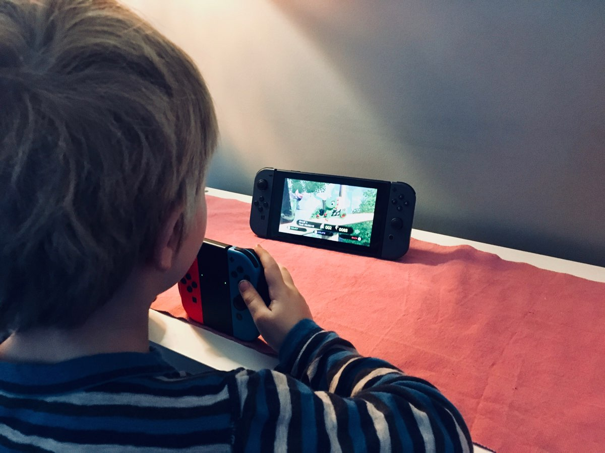 boy playing on a Nintendo Switch
