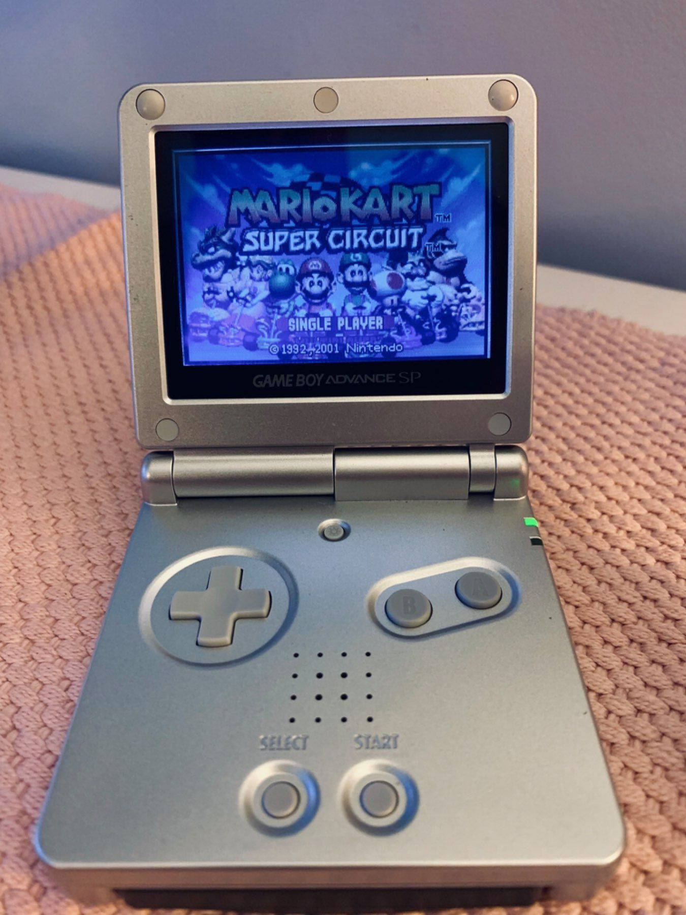 Nintendo Gameboy Advance SP. Mario Kart Super Circuit on screen.
